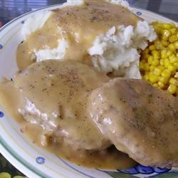 Poor Man's Hamburger Steaks Recipe - An old-fashioned hamburger steak recipe topped with a creamy mushroom sauce. Serve with some warm mashed potatoes and your favorite green vegetable. Our family loves this. Makes a great cheap meal!