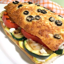 California Grilled Veggie Sandwich Recipe - For a smoky and sumptuous veggie-filled grilled sandwich, try this easy recipe. All it takes is some veggies, focaccia bread, lemon-mayonnaise dressing, and crumbled feta.