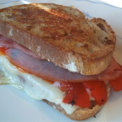 Grilled Roasted Red Pepper and Ham Sandwich Recipe - I came up with this sandwich on my own. My husband wanted a plain grilled ham and cheese sandwich and I decided to experiment with some ingredients from the fridge.  He absolutely loved it! Try using a chipotle mayonnaise to spice it up a bit.