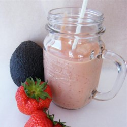Avocado Strawberry Smoothie Recipe - Avocado and strawberry smoothie with orange juice and vanilla yogurt is a great pick-me-up post workout or as an on-the-go breakfast.