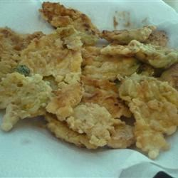 Crispy Zucchini or Pumpkin Blossoms Recipe - My Italian grandmother makes these fried zucchini blossoms every year when the zucchini in her garden start to bloom.