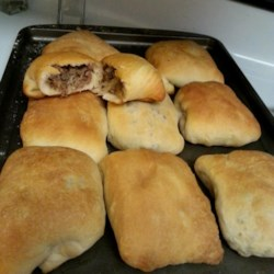 Bierrocks III Recipe - German pastry sandwiches filled with meat, cabbage and onions. If preferred, use any plain roll dough of your choice. Pastries can be frozen and reheated.