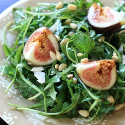 Fig and Arugula Salad Recipe - Sweet figs and peppery arugula make a simple salad with a drizzle of honey and balsamic vinegar.