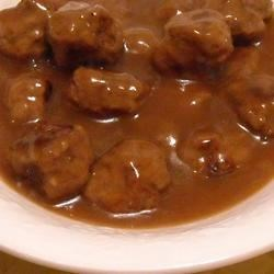 Sauerbraten Klopse (Sauerbraten Meatballs) Recipe - Beef meatballs seasoned with cloves and allspice. Pan fried, and smothered in gravy.