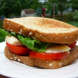 Kansas Tomato Sandwich Recipe - The simplest tomato sandwich ever created. You only need bread, a large tomato, cheese, tall glass of Sun Tea, and a nice comfortable chair to relax in. The classic gardener's relaxing meal.