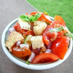Bruschetta Salad Recipe - Tomatoes, mozzarella cheese, basil, and bagel chips are mixed together with olive oil in this quick and easy bruschetta salad.