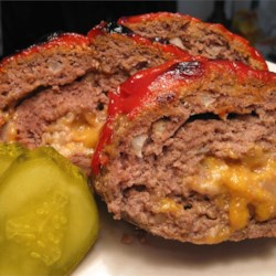 Cheeseburger Meatloaf  Recipe - Easy-to-prepare meatloaf, rolled and stuffed with cheese, or any number of other possible ingredients, such as sauteed onions and mushrooms.