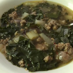 Almost Tuscan Sausage and Kale Soup Recipe - This Italian-inspired sausage and kale soup with cannellini beans and potatoes is similar to the Tuscan soup at a popular chain restaurant.