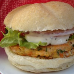 Yummy Lemon Salmon Burgers Recipe - A quick, delicious and nutritious way of serving salmon. You can enjoy this with or without the dressing, in a bun, or with a salad.