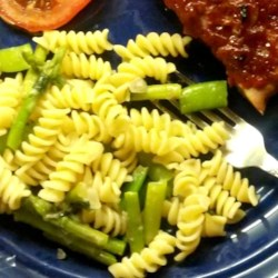 Yummy Summer Pasta Recipe - Whole-wheat rotini pasta are tossed with asparagus, sugar snap peas, Italian cheese, and basil for a light, summery pasta side dish to serve with simple grilled meats or chicken.