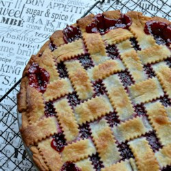Sour Cherry Pie Recipe - This is a sour cherry pie recipe that is SO simple I can put it together and get in the oven in less than 10 minutes.  The hardest thing about this pie is tracking down canned sour cherries but if you look carefully, you can find them in most grocery stores. When the pie is served, top with vanilla ice cream to add the element of sweet to the sour!