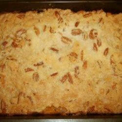Rum and Sweet Potato Casserole Recipe - This is a simple recipe for sweet potato casserole. But it is also the best I have tasted, enriched with eggs, milk, and rum, and topped with a crunchy pecan streusel. It is a standard at all holiday dinners in my family. The amount of rum can be varied according to taste (the casserole is also good without it, if you so desire.)