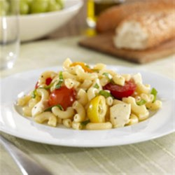 Barilla(R) Macaroni Pasta Salad with Cherry Tomatoes, Fresh Mozzarella and Basil Recipe - Take along a lovely cool pasta salad of Barilla(R) Macaroni pasta, halved cherry tomatoes, fresh mozzarella, and fresh basil.