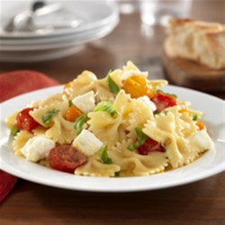 Barilla(R) Farfalle with Cherry Tomatoes, Fresh Buffalo Mozzarella Cheese, and Basil Recipe - The flavours of caprese - buffalo mozzarella, cherry tomatoes, and basil - combine with Barilla(R) Farfalle in this warm, summery pasta.