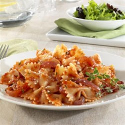 Barilla(R) Farfalle with Red Onions, Tomatoes, Thyme and Parmigiano Reggiano Cheese Recipe - A red onion, tomato and thyme sauce that comes together in just minutes is tossed with Barilla(R) Farfalle pasta, and topped with Parmigiano-Reggiano cheese.