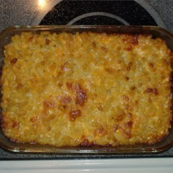 Lisa's Macaroni and Cheese Recipe - This warm, gooey casserole is an happy merger of macaroni, butter, milk, dashes of onion and garlic powders, a sprinkling of parsley flakes and three kinds of full-flavored cheeses. Just toss them all together and bake until perfectly melted.