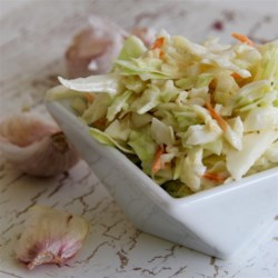 Vincent's Famous Garlic Coleslaw Recipe - This copycat garlic coleslaw recipe from a seafood restaurant is a zesty salad with a strong garlic profile, with apple cider vinegar and celery seeds.