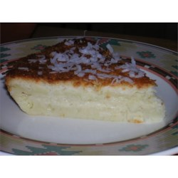 Amazing Coconut Pie Recipe - All the ingredients - milk, sugar, eggs, shredded coconut, Bisquick, vanilla and butter - are simply stirred up in one bowl and, amazingly, this mixture forms it 's own crust while baking.