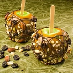 Seattle Caramel Apples Recipe - Trail mix adds a nutty texture to these delicious caramel apples.
