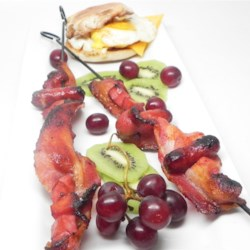 "Breakfast on a Stick Recipe - A the favorite pork products: bacon, ham, and sausage are threaded onto a skewer and baked into a tasty snack called ""breakfast on a stick""."