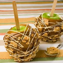 Peanut Butter Crunch Apples Recipe - Apples and peanut butter are a classic combination. Surprise your friends this fall with this crispy peanut butter cookie coated caramel apple creation.