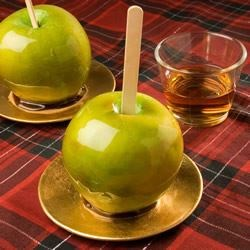 Bourbon Candy Apples Recipe - Bourbon adds a rich flavor to these hand dipped caramel apples.