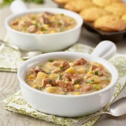 White Chili from Smithfield(R) Recipe - Garlic- and herb-seasoned pork loin is simmered with beans, potatoes, corn, and green chiles for a crowd-pleasing, warming bowl of chili.