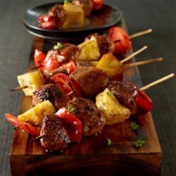 Sweet and Spicy Pork Mini Kabobs Recipe - Skewers of peppercorn and garlic-seasoned pork with pineapple and bell pepper are broiled and brushed with a sweet-hot-sour glaze.