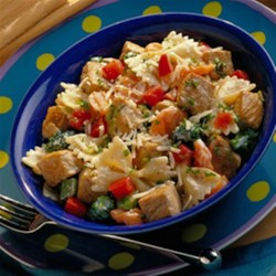Colorful Bow Tie Pasta Recipe - Chunks of seasoned boneless pork sirloin roast are quickly sauteed with broccoli and carrots, then tossed with herbs, grated cheese, bow tie pasta and more veggies for this colorful, main dish salad.