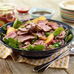 Peachy Korean BBQ Salad Recipe - This main course salad features grilled slices of pork loin, mixed greens, sugar snap peas, fresh peaches, cashews all tossed in an Asian sesame and ginger vinaigrette.