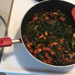 Dawn's Kale Side Dish Recipe - A mixture of kale and spinach are cooked with onions and garlic, and then tossed with toasted cashews. Goes excellent with fish or chicken.