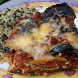 Eggplant Parmesan I Recipe - Wonderful directions for preparing eggplant if you've never done it before.  The eggplant is layered in a large pan with marinara sauce, mozzarella, ricotta and Parmesan cheese. This it 's baked until the cheese topping is golden.