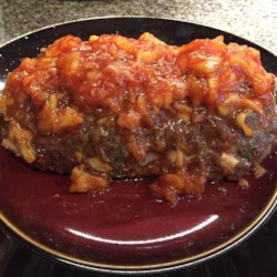 Best Meatloaf in the Whole Wide World! Recipe - Pineapple-bacon sauce bakes into a savory ground beef mix to create a sweet, smoky, and savory meatloaf masterpiece.