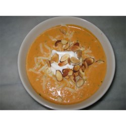 Savory Pumpkin Soup Recipe - This fragrant, creamy soup is a wonderful way to warm up during the holidays. Fresh herbs mildly complement the flavor of pumpkin. Mozzarella cheese is melted throughout, and toasted almonds add a pleasant crunch.