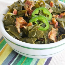 Slow Cooked Collard Greens Recipe - Tender, spicy, smoky collard greens simmering in a slow cooker are worth the wait.