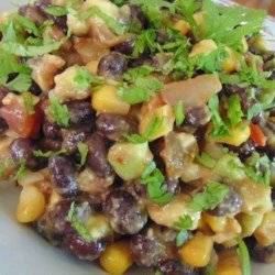 Mexican-Style Black Bean and Corn Salad Recipe - This mixture of black beans, avocado, corn, and bell pepper gets a boost of flavor from picante sauce and lemon juice for a delightful Mexican-inspired salad.