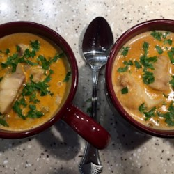 Curry Fish Stew Recipe - A creamy curry sauce is a wonderfully fragrant and flavorful complement to unpretentious cod.
