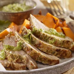 Pork Loin with Chimichurri Sauce Recipe - Pork loin filet is marinated in chimichurri sauce then roasted for this easy, elegant main course.