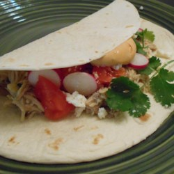 Slow Cooker Chicken Tacos with Chipotle Cream Sauce Recipe - Slow cooker chicken tacos topped with a smoky chipotle cream sauce is an easy meal to prepare for weeknights.