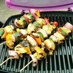 Chicken Kabobs Recipe - Place chicken and colorful veggies on skewers, grill, and enjoy! This is a quick way to enjoy a delicious barbequed meal.