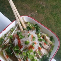 Pho Ga Soup Recipe - Pho ga, a Vietnamese chicken noodle soup, is topped with bean sprouts, lime juice, and Sriracha sauce for a refreshing and spicy meal.