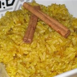 Indian Rice (Pulao) Recipe - Saffron threads lend a deep, golden color to this spice infused, Indian rice dish.