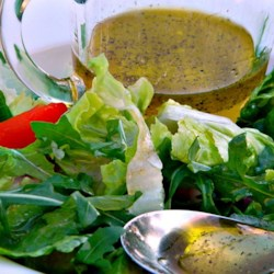 White Balsamic Vinaigrette Recipe - This copycat white balsamic vinaigrette recipe similar to Panera(R)'s recipe, using extra-virgin olive oil, honey, and fresh cracked black pepper.