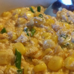 Quick Creamed Curried Corn  Recipe - A quick and easy side dish is seasoned with Indian-style spices and thickened with Greek yogurt for a creamy curried corn.