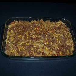 Hamburger Casserole Recipe - Salsa and taco seasoning mix give Mexican flavor to this beef and noodle casserole in which canned corn, tomatoes, and beans are included.