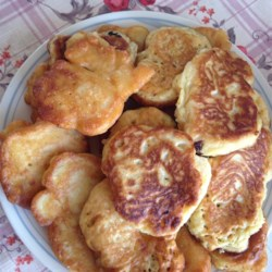 Corn Fritters with Maple Syrup Recipe - Served warm with maple syrup or honey, these corn fritters are great for breakfast or as a snack, and easier to make than you'd think!