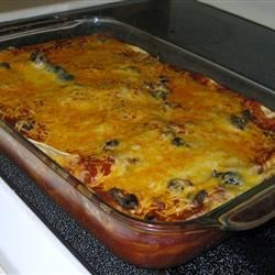 Cheater's Enchiladas Recipe - This is what we call fast and delicious cooking. Tortillas are layered with sour cream, cheese and olives in a baking pan, then finished with enchilada sauce.