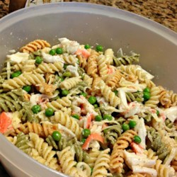Paul Newman Crab Salad Recipe - This pasta salad with imitation crab, peas, and cheese is dressed with a simple vinaigrette for a delightful potluck or picnic dish.