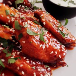 Crispy Honey Sriracha Chicken Wings Recipe and Video - Chef John's recipe for crispy, oven-baked honey sriracha chicken wings is the perfect addition to your Big Game party!