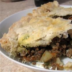 Tourtiere (Meat Pie) Recipe - A mixture of ground beef, ground pork, carrot, celery, potato for the savory wedded with spices like nutmeg, cinnamon and cloves for the sweet - meet a Tourtiere pie!